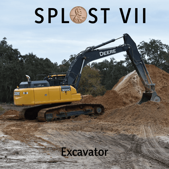 Image of Excavator moving dirt