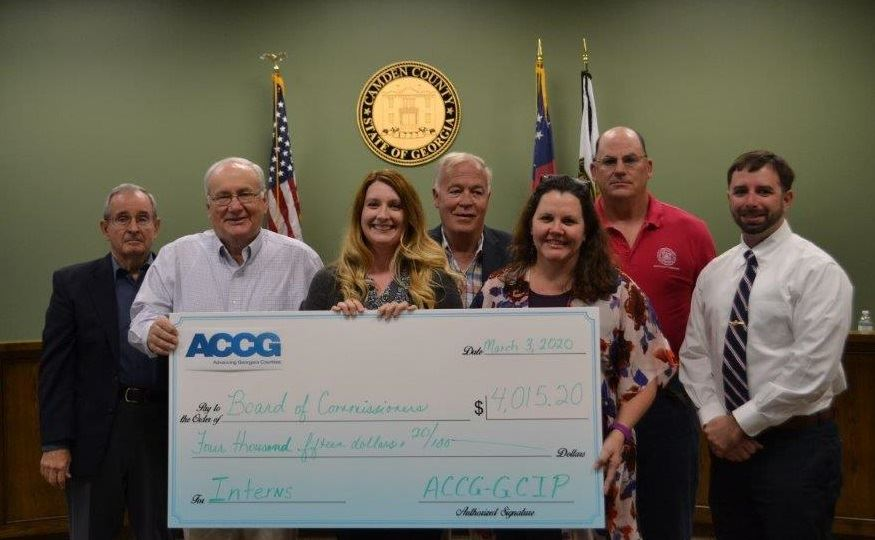 Commissioners and Staff Pose with Oversized Check